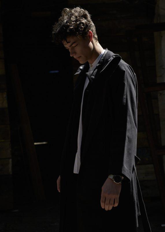 Shirt: Oliver Spencer Leather Jacket: John Varvatos Coat: Phoebe English Jeans: Fara Watch: Komono Shoes: Blundstone
